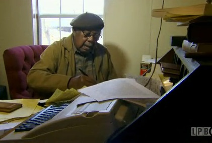 Ernest Gaines at his writing desk in 2013