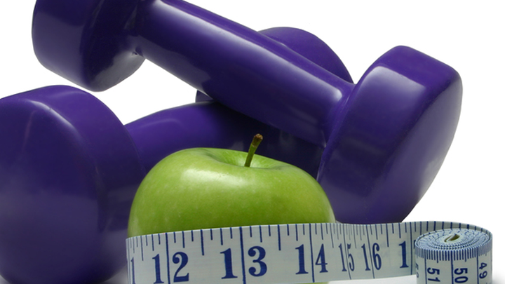 Picture of Weights, an apple, and a tape measure