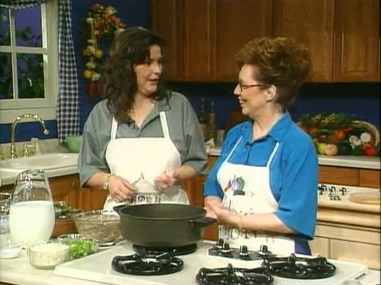 Ms. Lucy and her daughter cooking in the kitchen