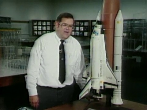 NASA Physicist Dale Bremmer with Space Shuttle model